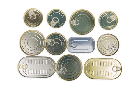 Various types of sealed tin cans of canned fish and seafoods on a white background, top view, background