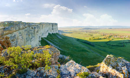 View of valley from the steep edge of limestone plateau in the morning, panoramic view