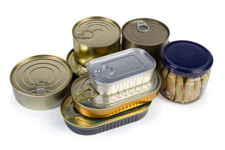 Set of canned fish and seafoods in various types of sealed tin cans and glass jar on a white background