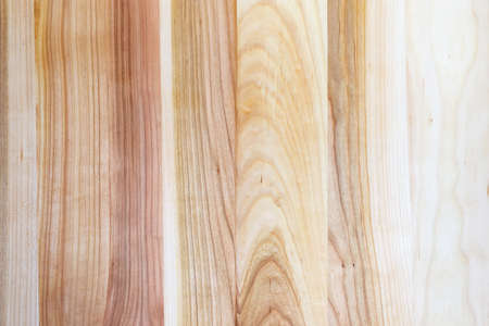 Background of texture of the wooden plank made of the ash-tree multiple pieces
