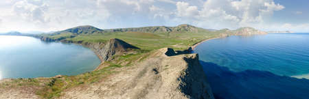 Hilly terrain on the seashore, coastal part of the sea. Wide panoramic view from the clay cape protruding into the sea