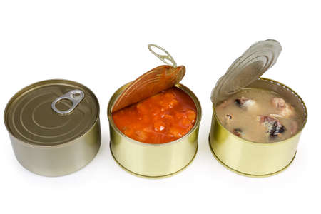 One sealed tin can and canned fish in its own juice with cooking oil addition, canned fish with tomato sauce in open tin cans on a white background Stock Photo