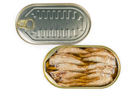 Smoked canned sprats in cooking oil in open tin can, sealed tin can on a white background, top view