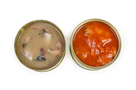 Canned fish in its own juice with cooking oil addition and canned fish with tomato sauce in open tin cans on a white background, top view 스톡 콘텐츠