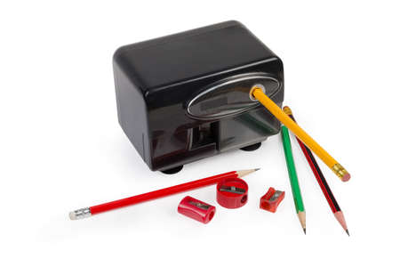 Modern desk electric pencil sharpener with  auto-stop and AC-powered, several manual prism sharpeners and pencils on a white background 스톡 콘텐츠