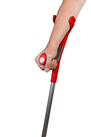 Male hand holds the modern metal elbow crutch, fragment of crutch top part on a white background 스톡 콘텐츠