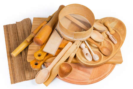Pile of various kitchen utensils made from different natural wood type on a white background Foto de archivo