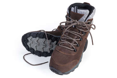 Pair of brown leather trekking boot on a white background, view from the toes side  스톡 콘텐츠