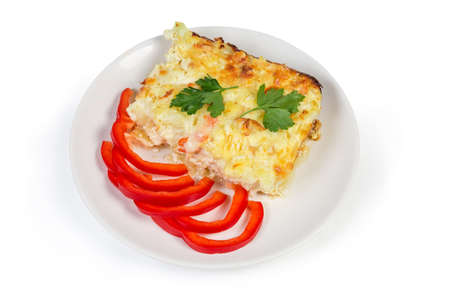 Cauliflower, seafood gratin portion, bell pepper slices on dish