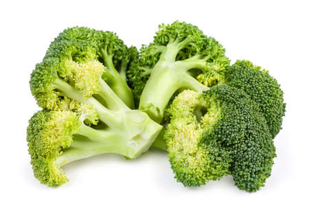 Small branches of fresh broccoli on a white background close-up in selective focus
