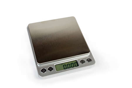 Professional high precision digital table top scales with LCD display and empty stainless steel platform on a white background