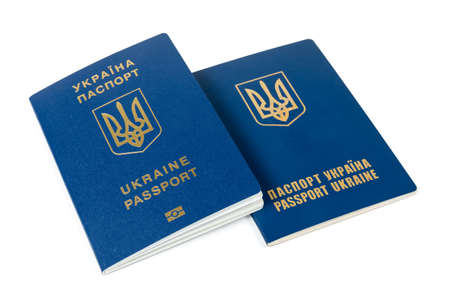Ordinary biometric Ukrainian passport and previously issued non-biometric passport on a white background, view from the front covers side