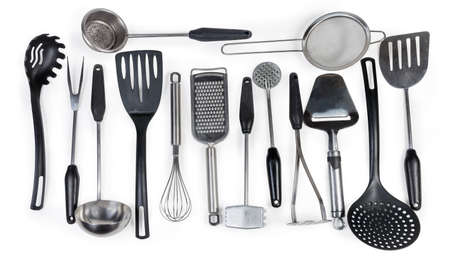 Items of cooking utensils for various purposes made with stainless steel and plastic and laid out on a white background Reklamní fotografie - 138171694