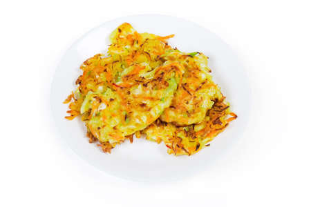 Fried savory cabbage pancakes on white dish on a white background Archivio Fotografico - 142425326