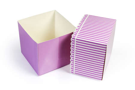 Empty small pink rectangular cardboard gift box and removed striped lid on a white background 스톡 콘텐츠