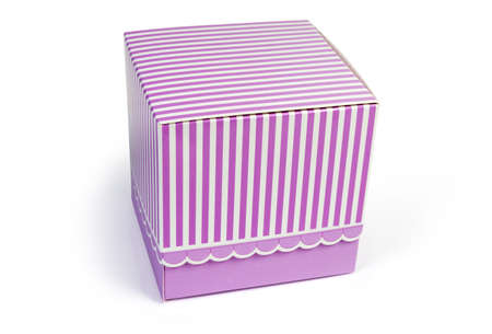 Small pink striped rectangular cardboard gift box with closed lid on a white background 스톡 콘텐츠