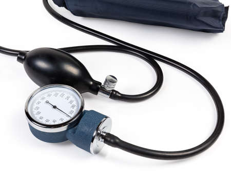 Classical manual mechanical sphygmomanometer on a white background, aneroid manometer and rubber bulb with valve close-up