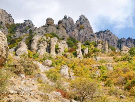 Limestone weathered rocks among the autumn forest on the mountain slope, bottom view