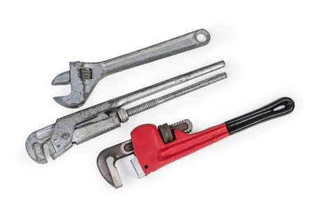 Modern heavy duty pipe wrench, used plumber wrench and adjustable wrench for hexagonal fasteners on a white background, top view