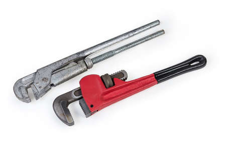 Modern heavy duty pipe wrench and old used plumber wrench on a white background