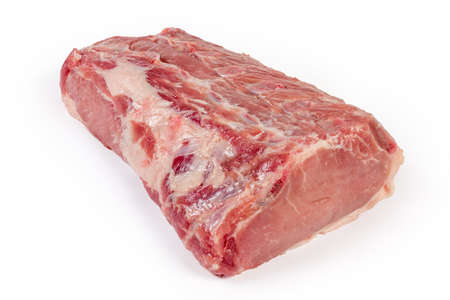 Big piece of the fresh uncooked pork loin with small parts of the ribs on a white background close-up