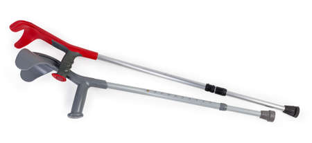 Two different modern metal elbow crutches with comfy ergonomic plastic handles and height adjustment on a white background