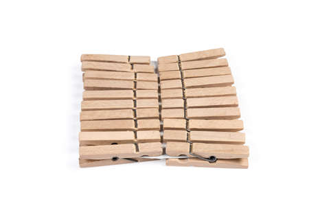 Set of new wooden clothespins spring type on a white background, close-up in selective focus 版權商用圖片