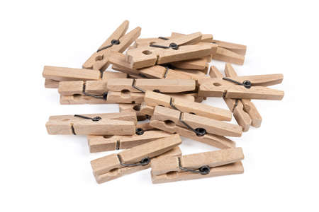 Pile of new wooden clothespins spring type on a white background, close-up in selective focus 版權商用圖片