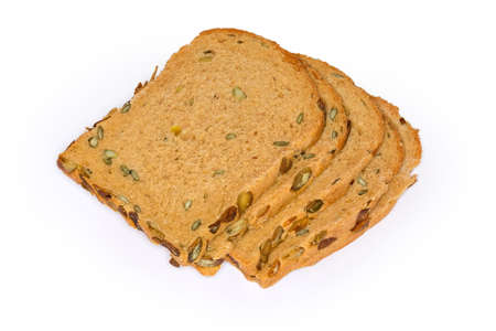 Slices of brown bread with pumpkin seeds and adding pumpkin juice in dough in the making, close-up on a white background