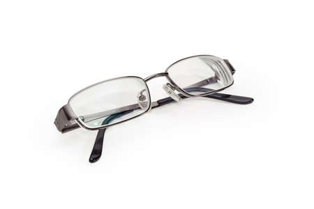 Modern eyeglasses in metal gray rim with folded temples on a white background 스톡 콘텐츠