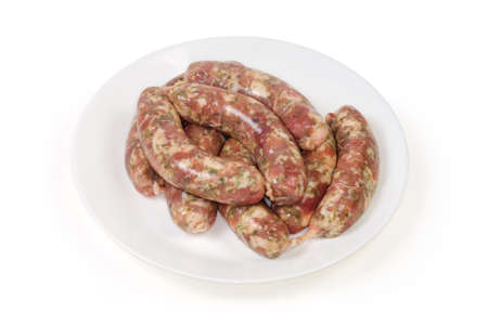Raw homemade pork sausages, prepared for further grilling on a white dish on a white background, semifinished Stock fotó