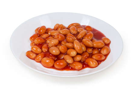 Boiled beans stewed with tomato sauce on a white dish on a white background, close-up in selective focus