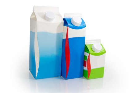 Cartons of different sizes with milk and fermented milk products with screw caps on a white background