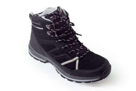 Single black trekking boot on a white background