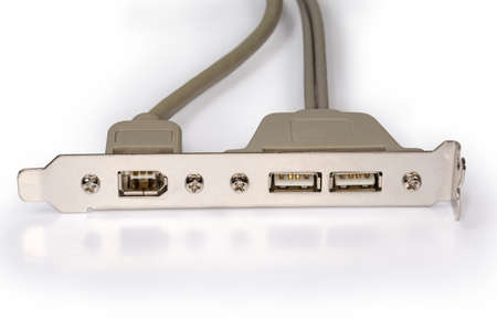 Computer back bracket with coupled connectors and cables for connecting external devices on a white background, close-up in selective focus