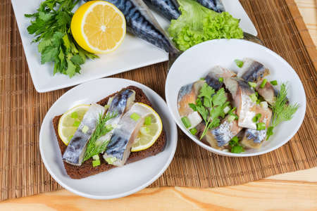 Smoked Atlantic mackerel slices and open sandwich with salted mackerel