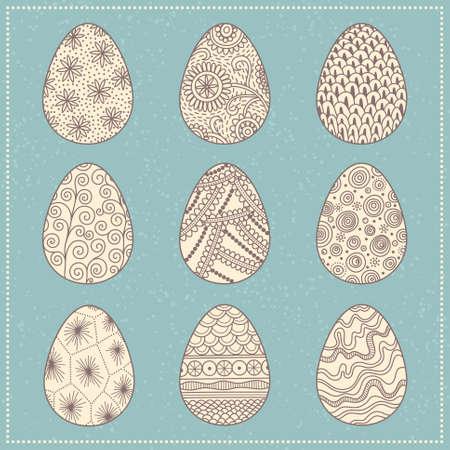 Conjunto de los huevos de Pascua decorativos estampados sobre fondo turquesa Vectores