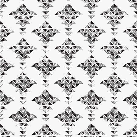 Seamless background with abstract shapes from black triangles on white backdrop