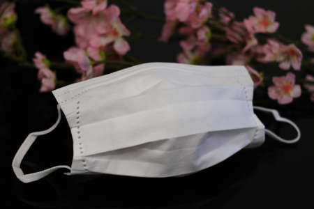 White mask and cherry blossoms (black background)