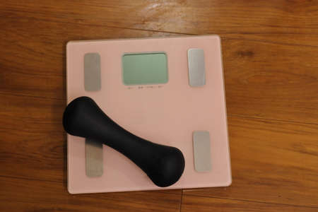pink weight Scale and dumbbell