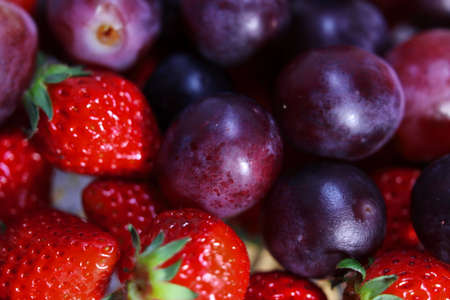 strawberries and grapes background.