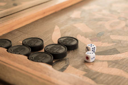 Board for a game of backgammon with two dice Stock Photo