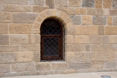lattice window: Lattice in a vintage style window in stone wall Stock Photo