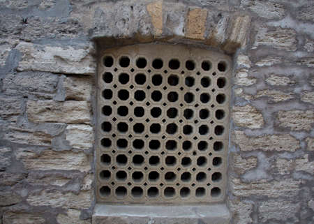 window grill: Window grill design of an old middle eastern architecture. Classic facade architectural details.