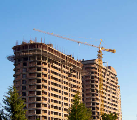 Building construction with crane. Blue sky background Stock Photo