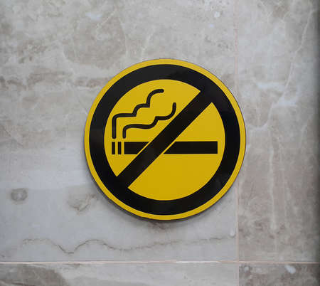 disapprove: No smoking signage on the wall. No cigarette smoking sign Stock Photo