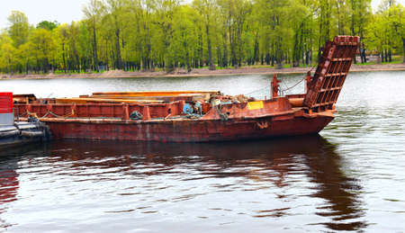 The old barge on the river mooring Stock Photo