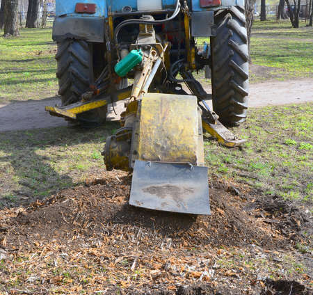 rooting out stub using the bulldozer with grubber