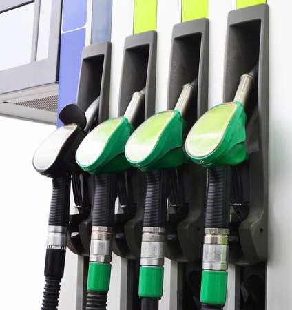 fragment of a fuel-dispensing column on petrol station. four filling hoses.