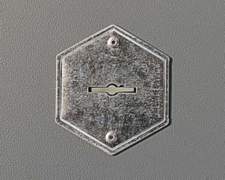 steel keyhole on the gray metal door